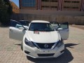 nissan-altima-white-with-low-miles-small-1